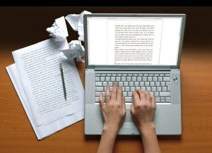Author-writing-book-on-on-computer